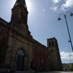 Stalybridge Town Hall with Holy Trinity in the background